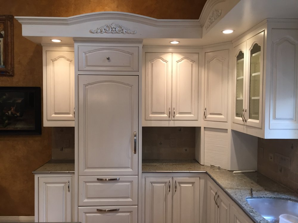 These kitchen cabinets were finished in an off white with a light glaze.