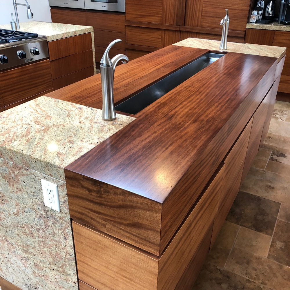 we refinished these beautiful mahogany counter tops with a water based non-toxic conversion varnish.
