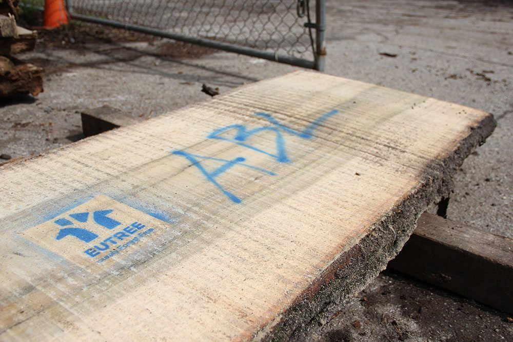 More stenciling is applied to identify the boards slated for Westside Trail.