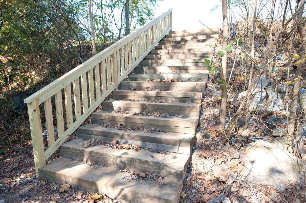 White oak outdoor staircase and railing constructed by Urban Eco Group.