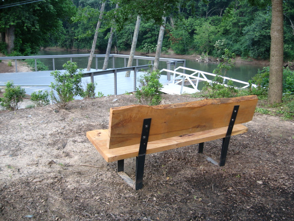 Eutree designs and fabricates outdoor white oak benches overlooking the Riverview Landing dock.