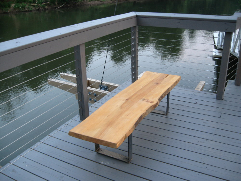 Benches are placed on the dock over the Chattahoochee River. The dock is utilized by Georgia Tech Crew (rowing) team and REI Outdoor School outpost for kayaking and other water sports.