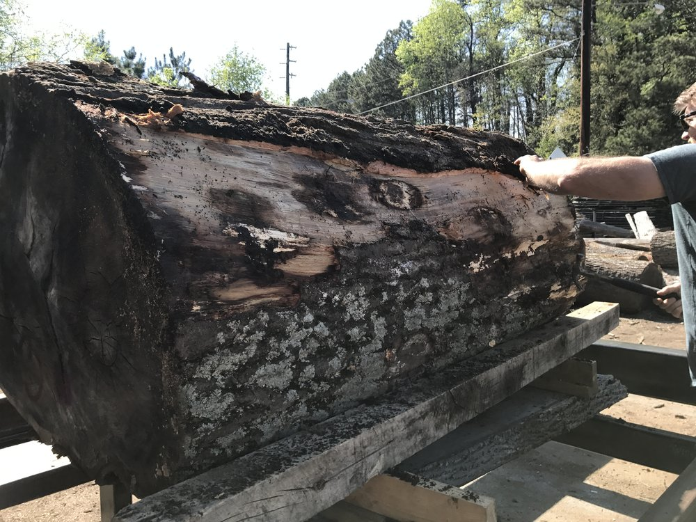 Prior to sawing, the log is inspected and assessed for quality (e.g., nails, metals or other foreign objects).