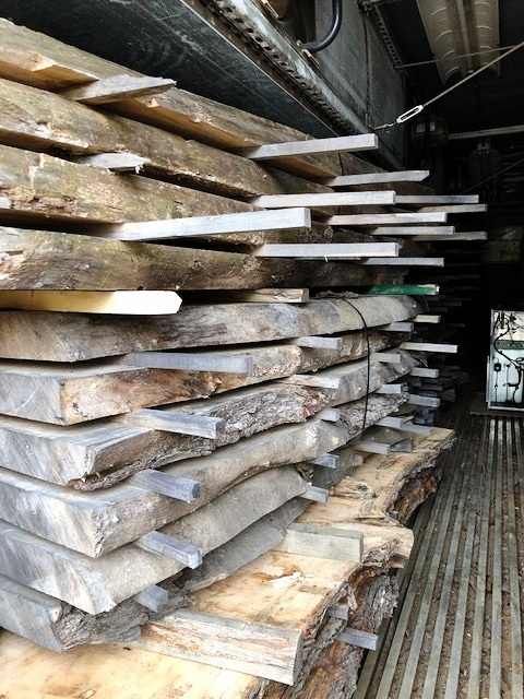 """Freshly cut slabs are referred to as """"green slabs"""" until they go through the drying process. After air drying outdoors in the lumberyard for 12 months, the slabs are loaded into the kiln to heat dry for 30 days. This photo was taken on Day 1 of the kiln drying process."""