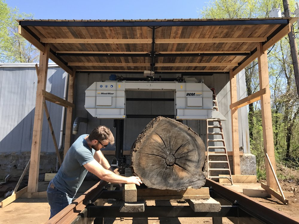 Hydraulics on the mill allow our sawyers to rotate the heavy log automatically to position the log properly for sawing.