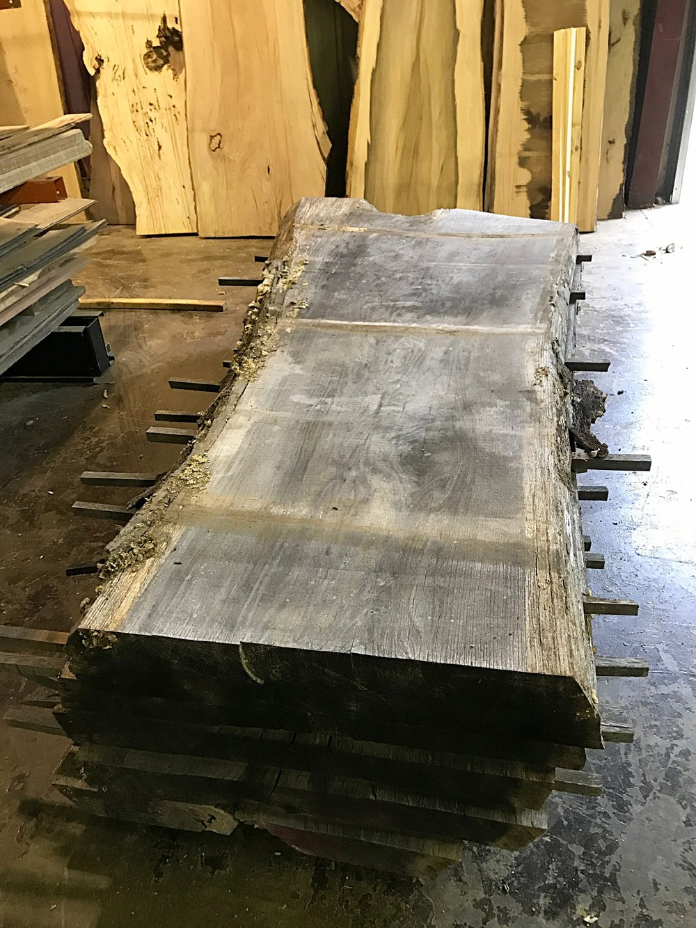 The kiln dried slabs are brought into the warehouse by forklift to be surfaced on the sanders.