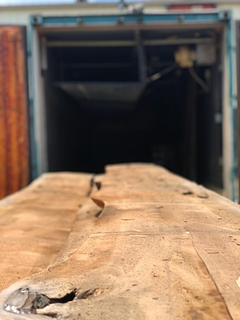 The slabs are heat dried in the kiln for 30 days. After the drying process, the kilns are reopened and the slabs are surfaced, and then transported to Skylar Morgan Furniture + Design to be made into custom furniture items for the hospital.