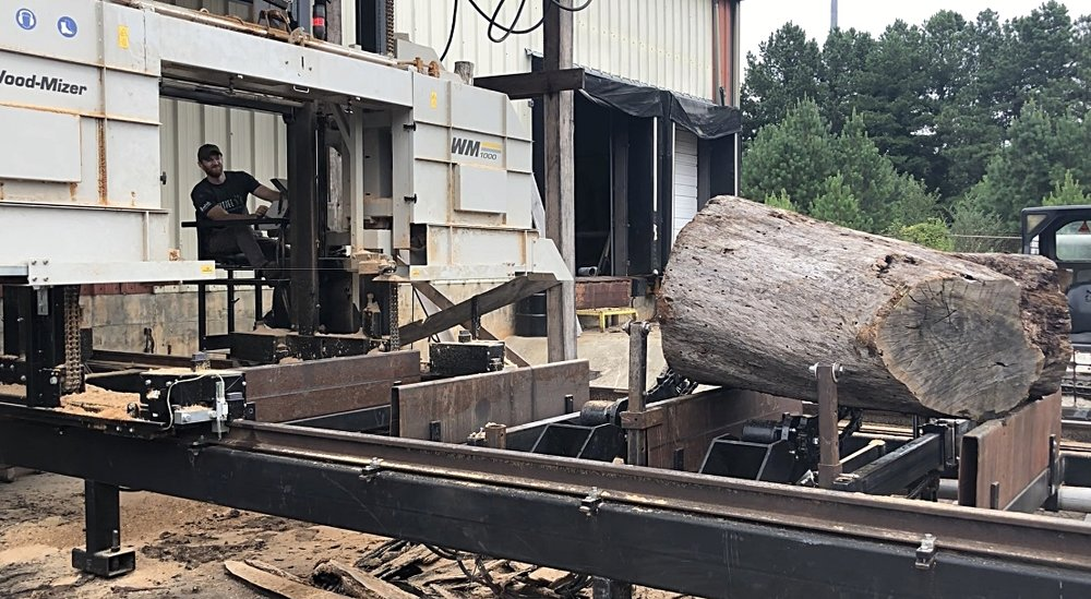 Eutree's Chief Sawyer, Sims, positions the head of the saw and begins to mill the log into slabs.