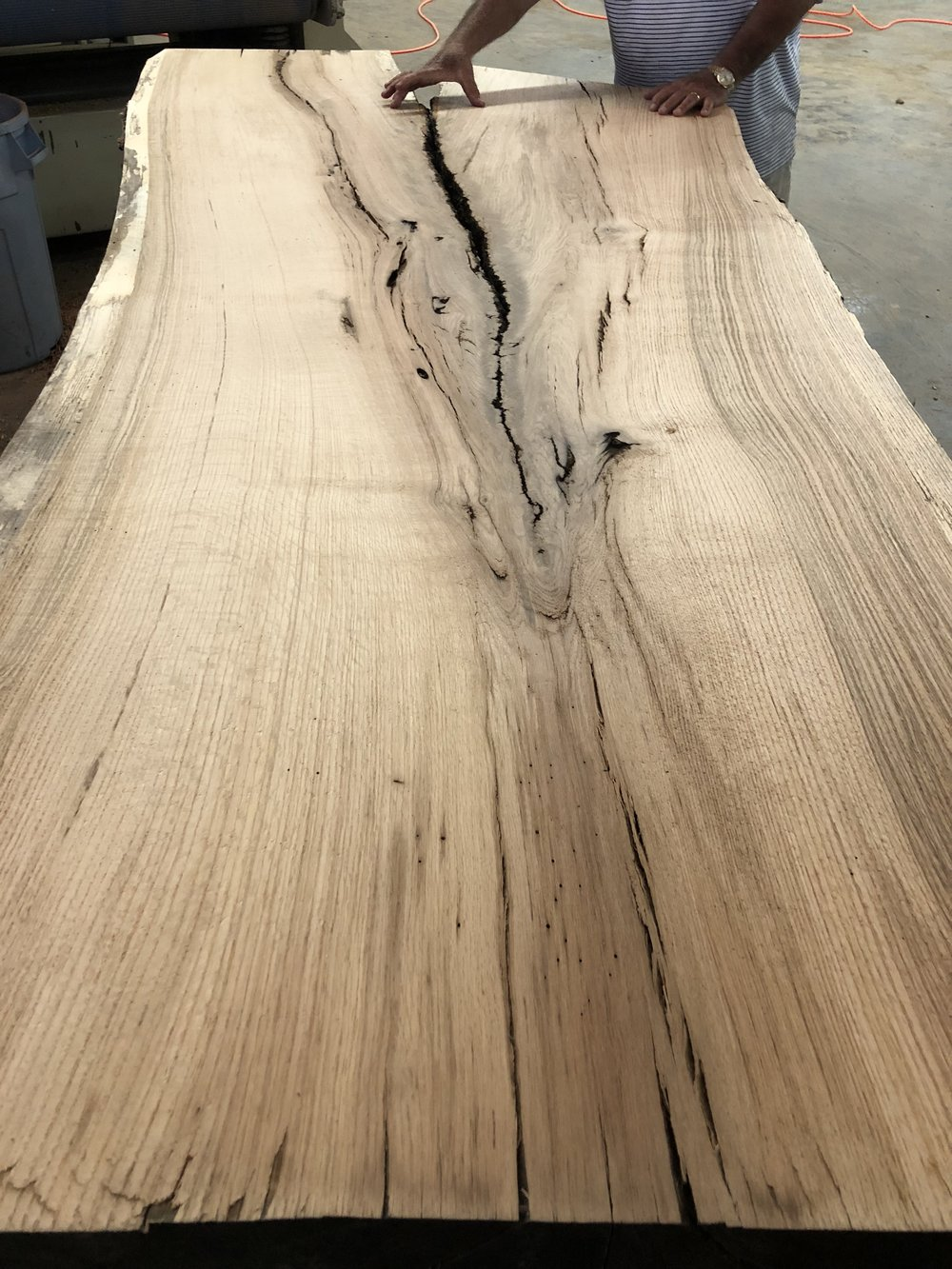 The client picked up the slabs the same day the slabs were surfaced, and delivered to a furniture maker where they will be finished into tables.