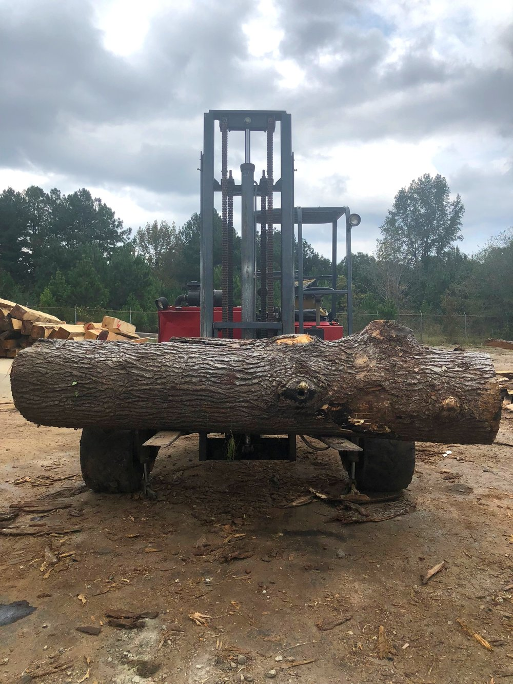 Logs are taken from the lumberyard and loaded onto the Wood-Mizer 1000 to begin the milling process.