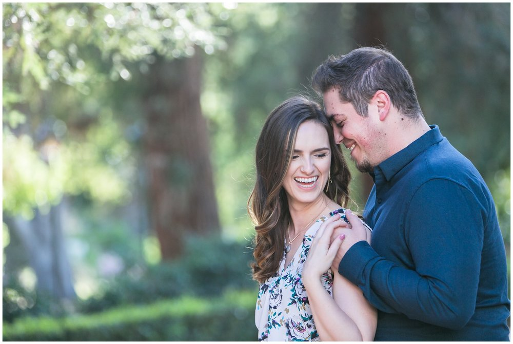 pomona-college-claremont-engagement-session-engaged-couple-snuggling-looking-happy-carrie-vines