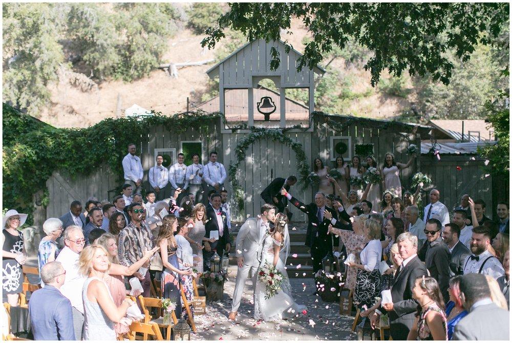 Copy of elegant homestead wilshire ranch wedding bride groom kiss ceremony carrie vines