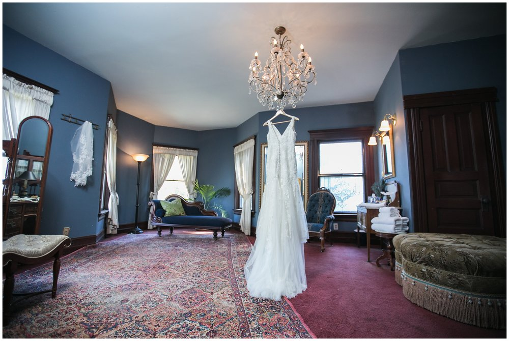 Christmas House Inn and Gardens wedding dress hanging from bridal suite chandelier carrie vines