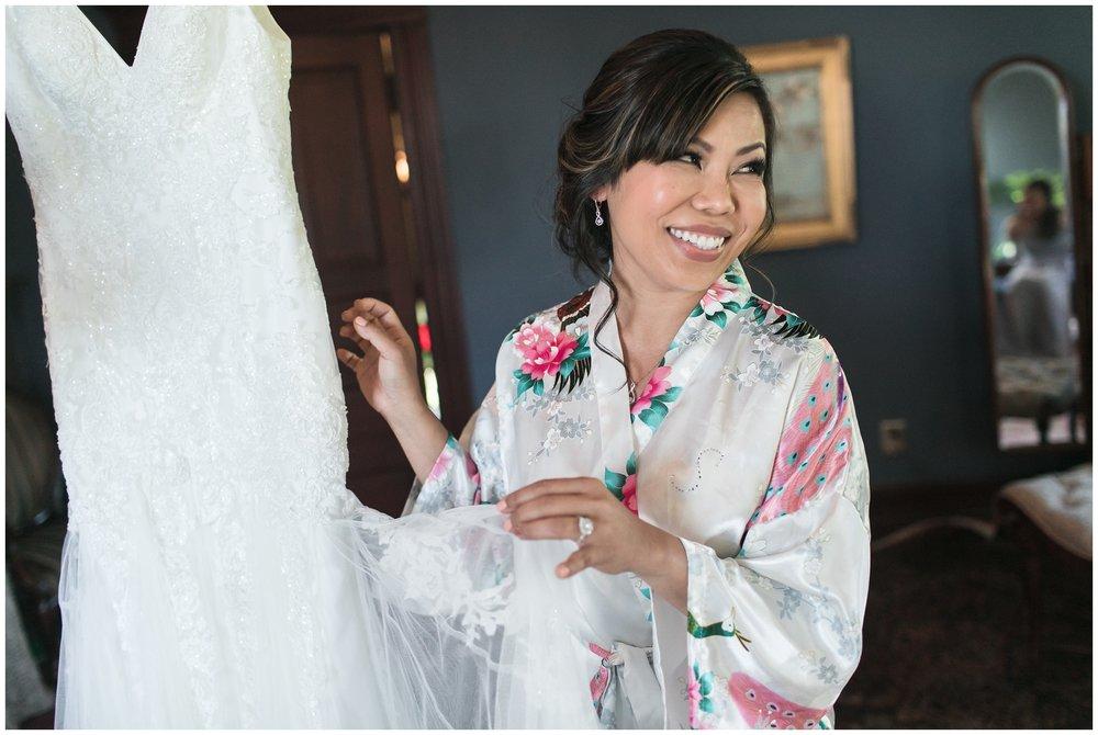 Christmas House wedding bride smiling holiding wedding dress carrie vines