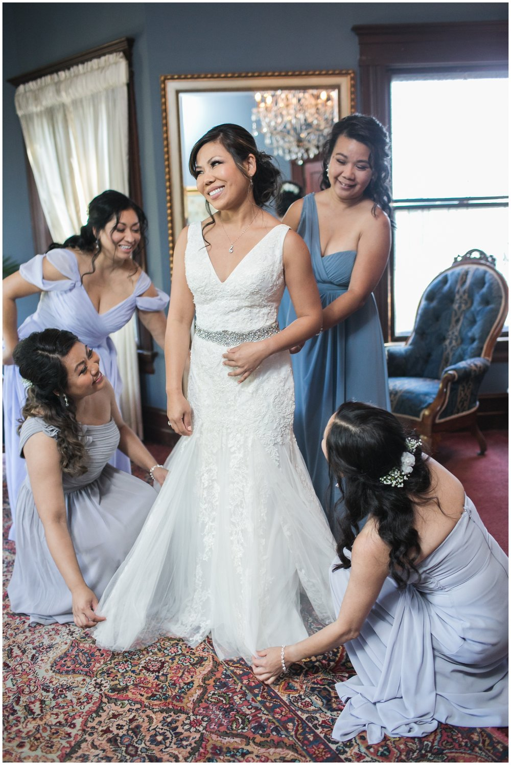 christmas house bridesmaids helping bride into dress carrie vines