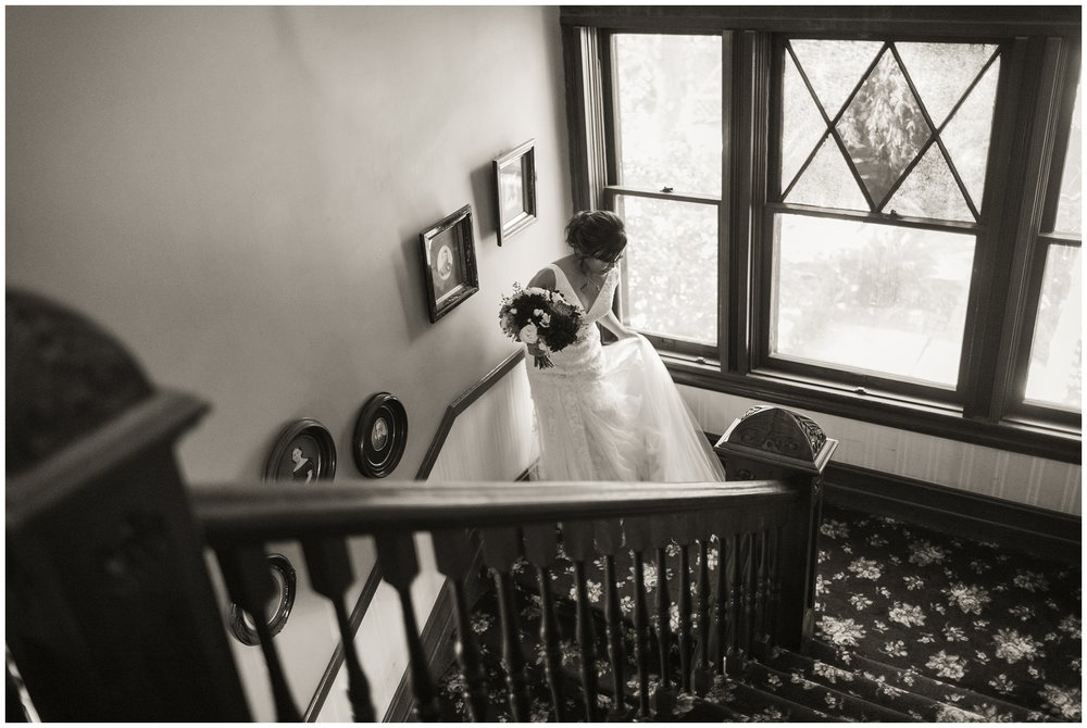christmas house wedding black white image of bride coming down stairs carrie vines