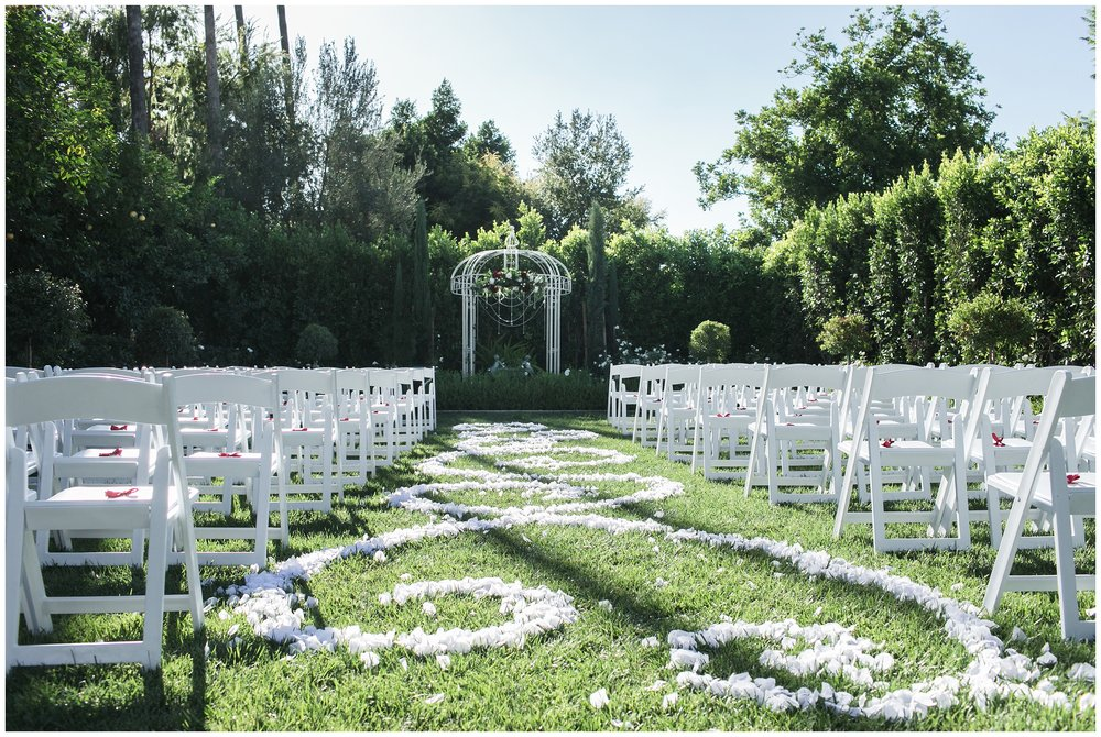 christmas house wedding white garden flower petal scroll design in aisle carrie vines