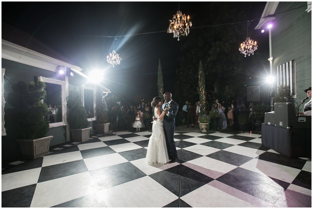christmas house wedding bride and groom first dance on checkerboard floor carrie vines