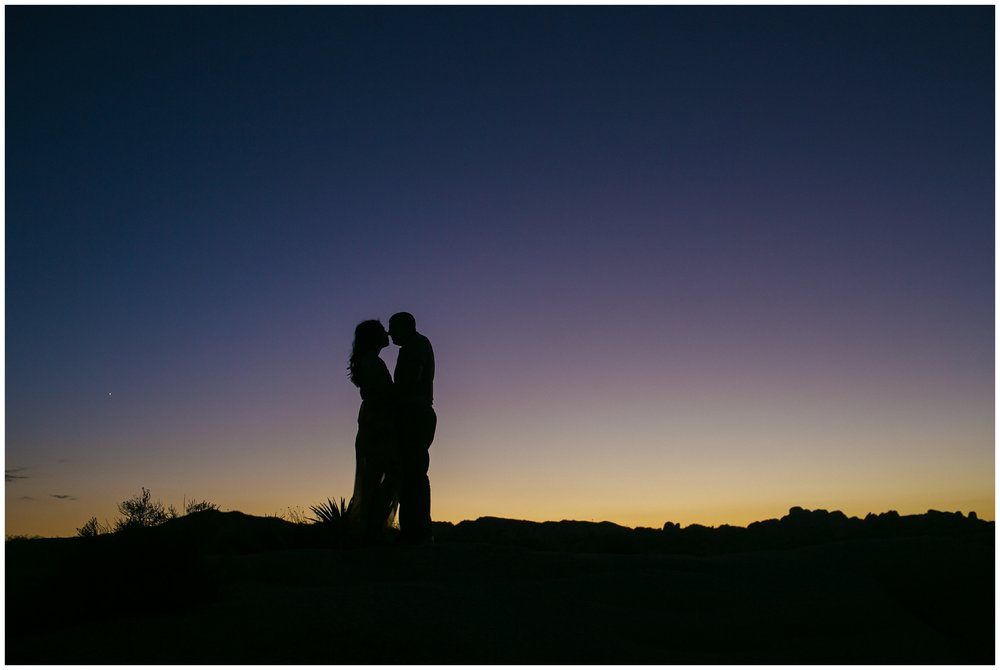 silhouette of couple in desert sunset Joshua Tree Engagement Session, Desert Engagement Session, Palm Springs Wedding Photographer Carrie Vines