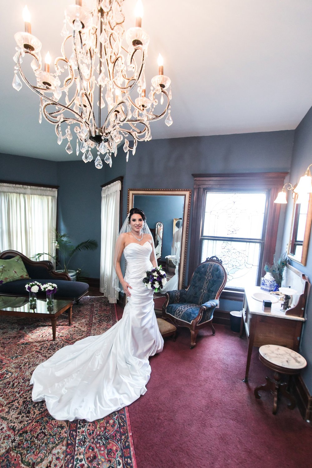 christmas house inn and gardens wedding carrie vines photography elegant bridal portrait under giant chandelier
