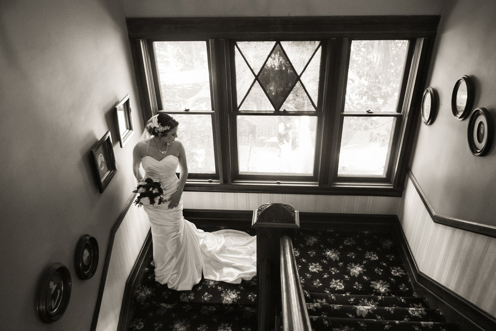 christmas house inn and gardens wedding carrie vines photography black and white portrait of bride on staircase