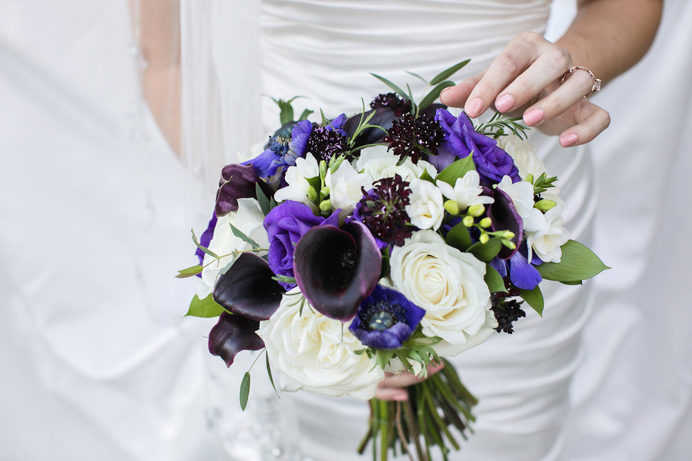 christmas house inn and gardens wedding carrie vines photography bridal bouquet in shades of dark and light purple and white by wisteria grove black cala lily white roses
