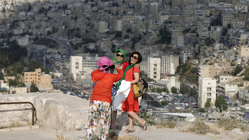 Chinese tourists visiting the Amman Citadel, an ancient Roman landmark
