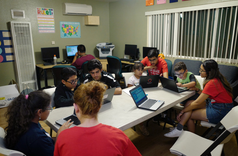 Some of the volunteers, in red, with the Open Sesame Coding for Kids project help 13 children attending a computer coding class at Thomas House in Garden Grove, a temporary shelter for homeless families on Friday, Nov. 2, 2018. (Photo by Michael Fernandez, Orange County Register Contributing Photographer)