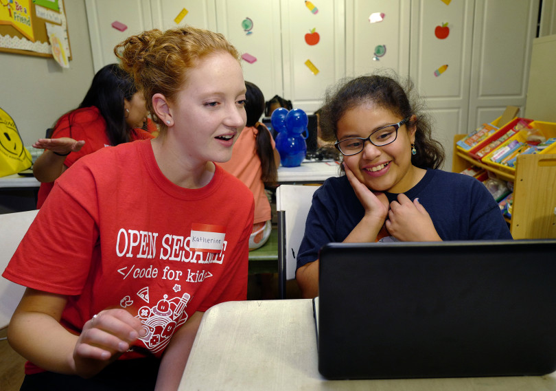 Katherine McPhie, co-founder of the Open Sesame Coding for Kids project, shares the excitement of Leslie, 10, during a computer coding class at Thomas House in Garden Grove, a temporary shelter for homeless families on Friday, Nov. 2, 2018. (Photo by Michael Fernandez, Contributing Photographer)