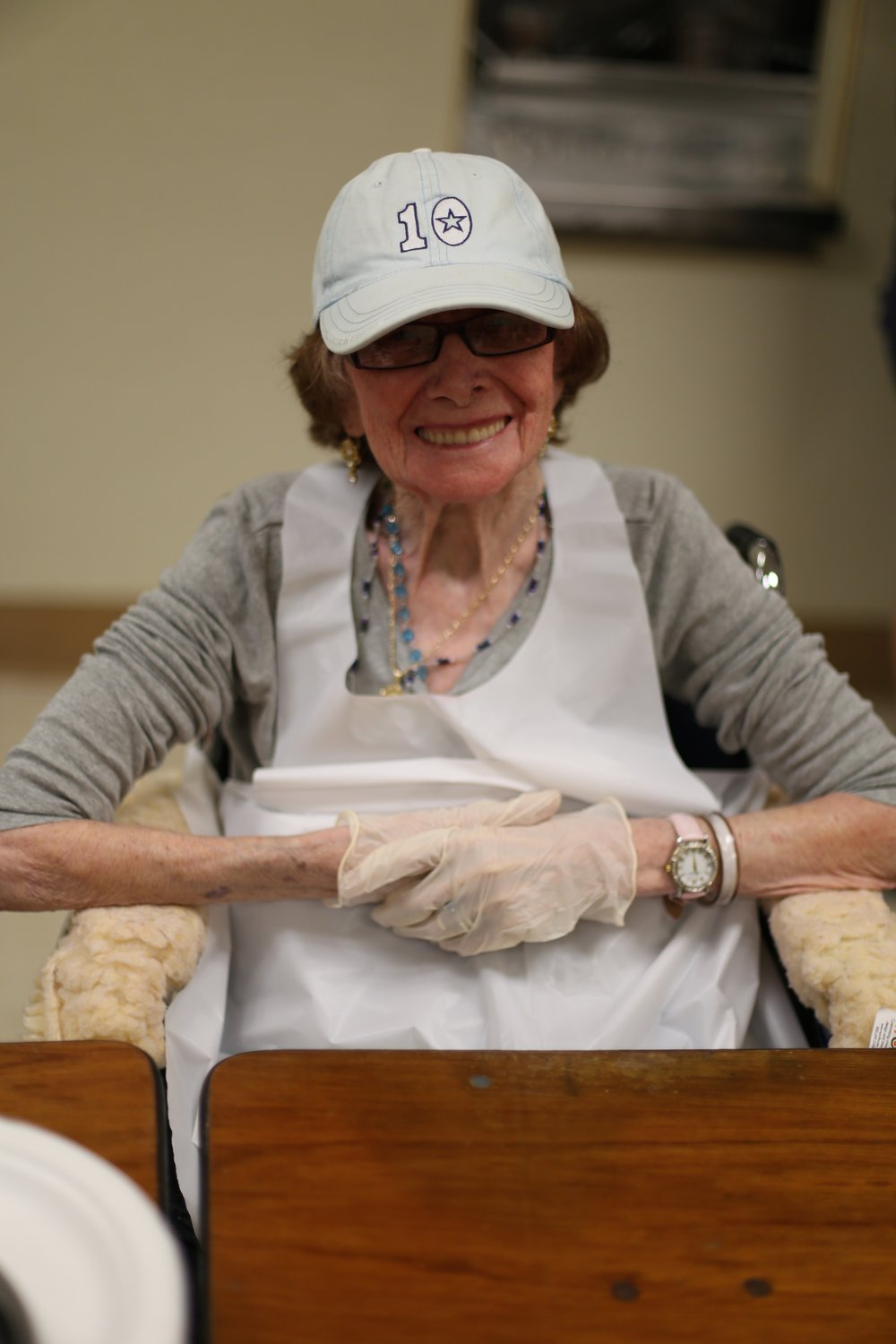 Noreen all smiles, getting ready to serve lunch at Salvation Army. Photo courtesy of Vienna.
