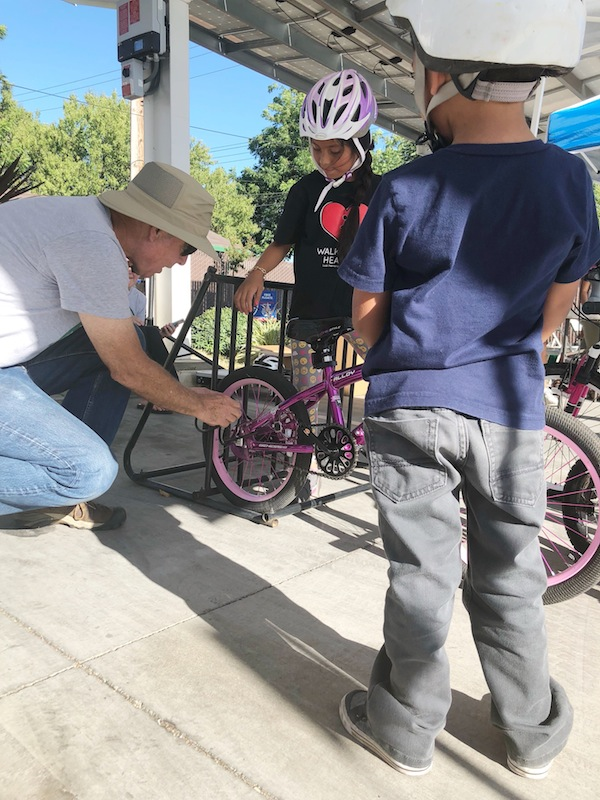 A few young participants learn how to properly lock up their bikes.