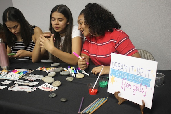 Three of the girls painting inspiration rocks for the conference. Picture compliments of Lodi Soroptimist.