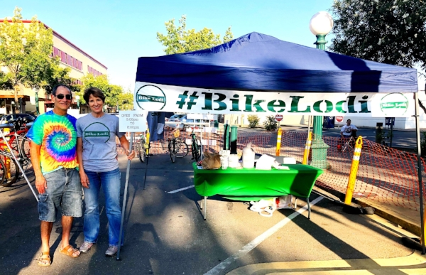 Bill Mitchell and Kathryn Siddle at Farmers Market bike valet station.
