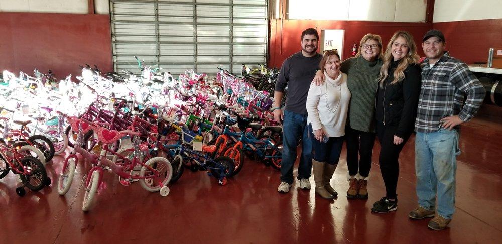 Lodi Satellite Rotary Dropping Off Bikes for Lodi Adopt-a-Child