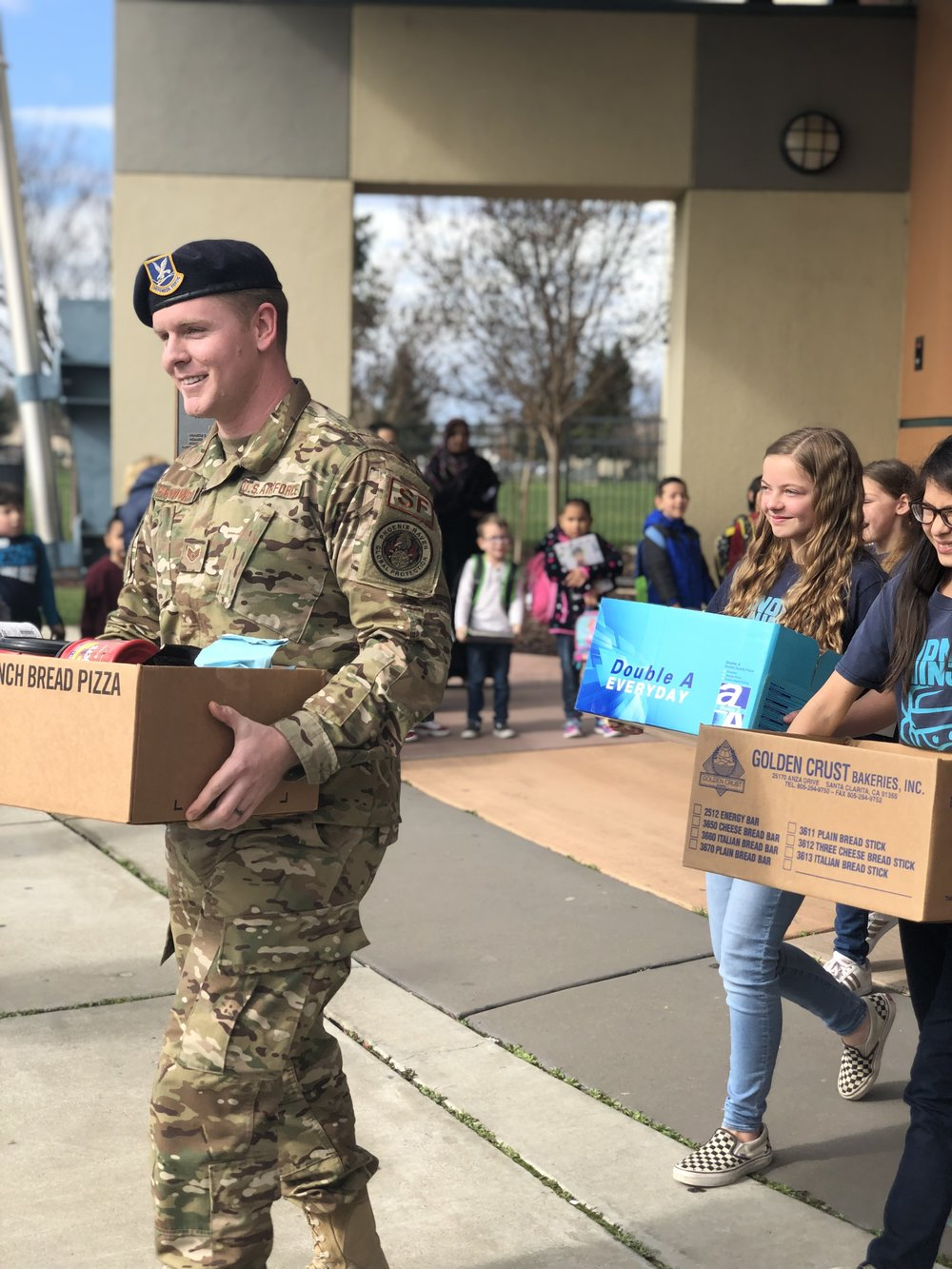 Soldiers loading coffee with the Borchardt Kindness Crew
