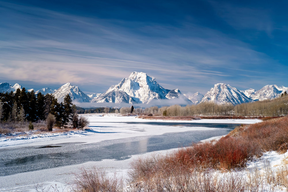 This image was from another last minute trip to Jackson, Wyoming. I've always wanted to see Grand Teton in the winter and with a perfect window of good driving conditions (at least on the way up) Reg and I decided to go for it. This image just brings about wonderful memories walking along the banks of the Snake River at Oxbow Bend and just enjoying the crisp winter days and the slow moving water underneath the frozen river toward Mt. Moran. It was so peaceful. No one else around.