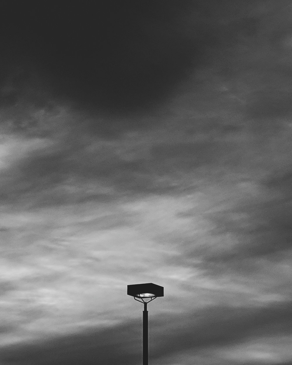Day 12- 365 B&W Challenge - A simple lamp post against the evening sky - Google Pixel 3, Moment 58mm Tele Lens, VSCO B5