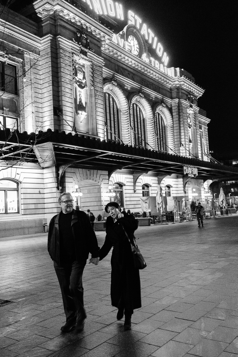 Couple walking in front of Union Station