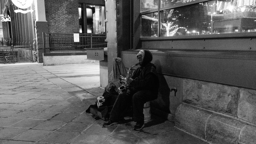 Saxophonist playing for money