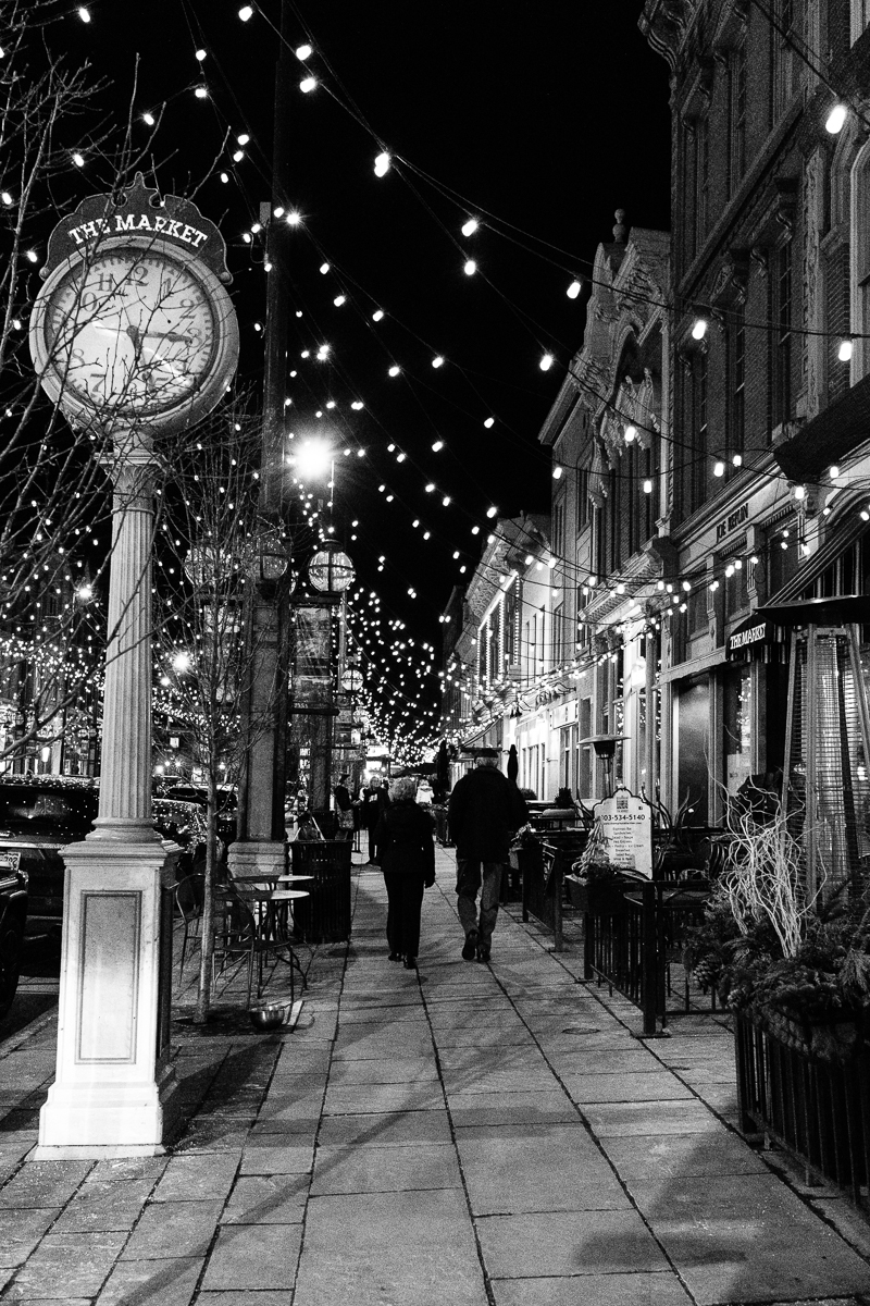 Walking by the Market Clock in Larimer Square