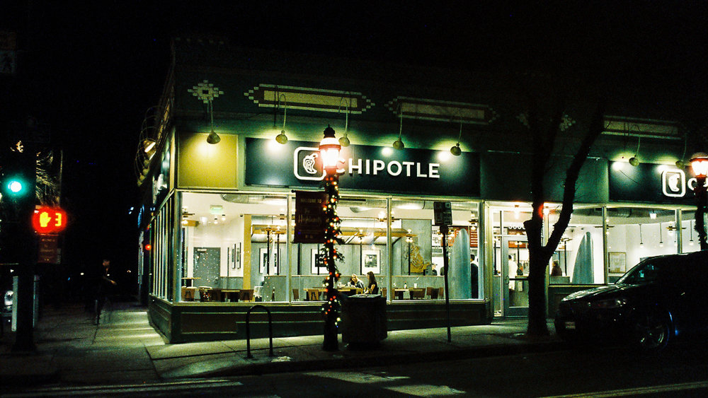 The lighted street corner at Chipotle in the Highlands