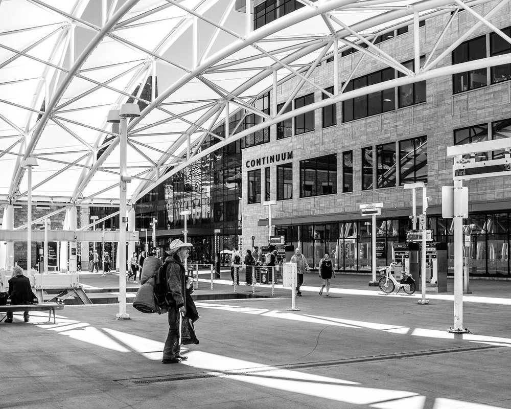 Day 105 - 365 Day B&W Photo Challenge - A weary traveler carries his belongings through the Union Station Complex in Denver, Colorado - Fuji X100F, Acros R Film Simulation