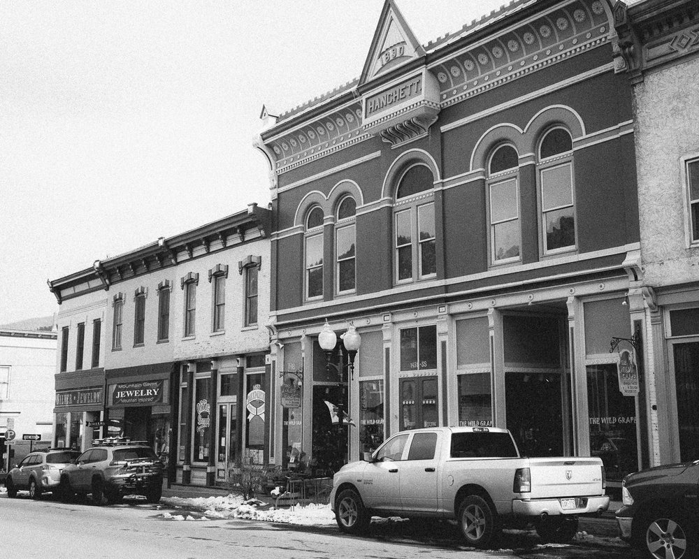 Day 106 - 365 Day B&W Photo Challenge - The Hanchett Building is one of the historical markers in Idaho Springs originally built in 1890 by Silas Hanchett, a businessman and part owner of the Lamartime gold mine - Fuji X100F, VSCO Ilford Delta 3200 + film preset