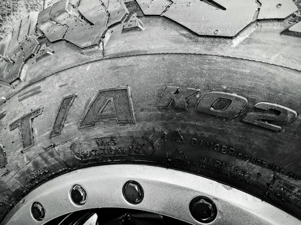 Day 73- 365 Day B&W Photo Challenge - My Toyo AT/2s served me well with over 60K miles on them, but they were never really good in the snow.  Since they were down the wear bars I figured I'd try these BF Goodrich All Terrain AT K02's a try. Everyone seems to rave about them so I thought I'd see if they lived up to their hype. These are snow rated so hopefully they are good in the snow, especially with the storm coming on Wednesday. These don't have a mileage warranty so I doubt they will last as long as my Toyo's, but we'll find out. - Google Pixel 3, VSCO B5 Film Simulation