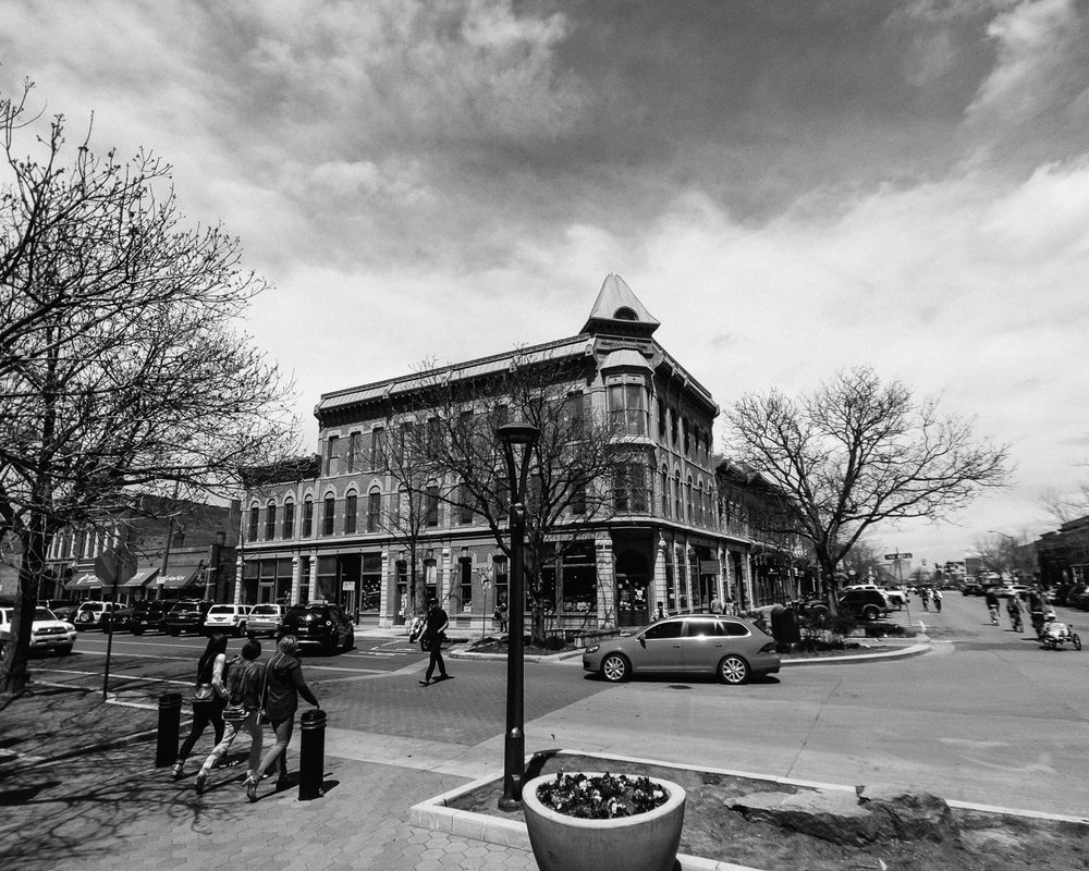Day 120- 365 Day B&W Photo Challenge -  This is Historic Old Town Fort Collins, Colorado. Old Town Fort Collins was the inspiration behind Main Street Disneyland. Old Town remains charming with it's unique brick buildings and architecture and cobblestone streets. Just a few blocks away the train still runs through the middle of town.. - Google Pixel 3, Moment Wide Lens, VSCO Fuji Neopan Acros 400
