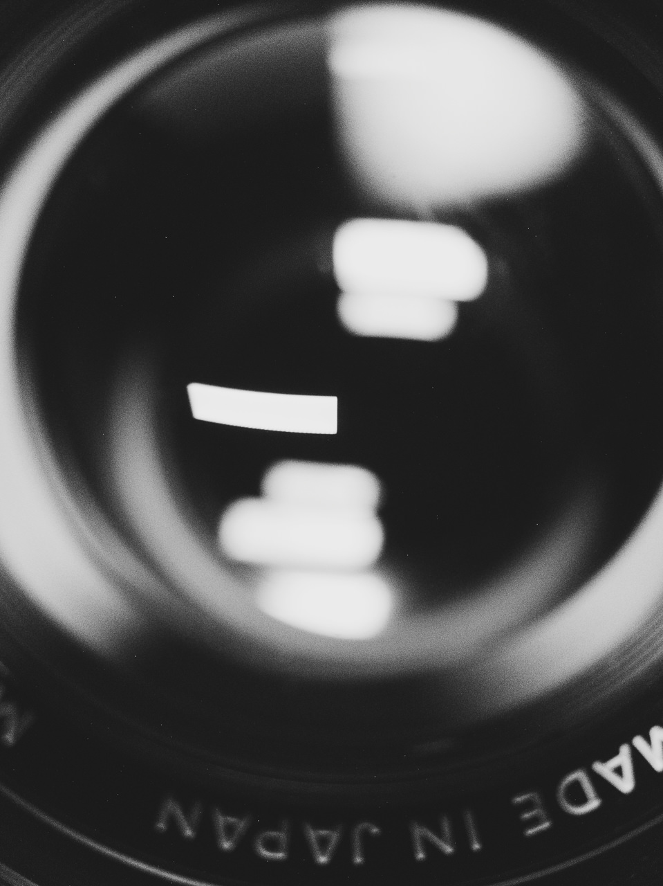 Day 124- 365 Day B&W Photo Challenge - Reflections off of my Minolta 50mm f/1.4 Lens. - Google Pixel 3, Moment Macro Lens, VSCO kx4 preset