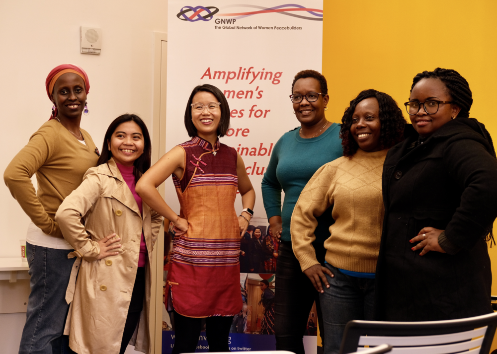 Jamie (third from left) with international feminists at leadership workshop.