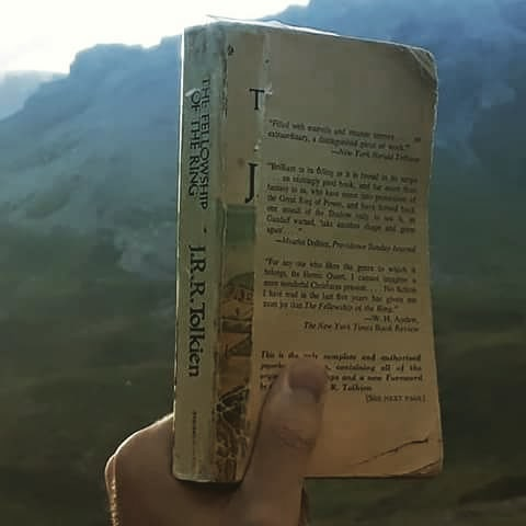 "This copy of ""Fellowship of the Ring"" has traveled many thousands of miles. It's dogeared and stained pages kept my brother and I warm at night through thunderstorms,  under bridges,  and in fields across most of mainland Europe.  As we traveled we would sing it's songs and identify with its characters. This is my brother holding the same copy that we got when we were 16. He carried it for a month through the Swiss Alps most recently. ""The road goes ever on and on.  Down from the door where it began. Now far ahead the Road has gone, And I must follow, if I can, Pursuing it with eager feet, Until it joins some larger way Where many paths and errands meet. And whither then? I cannot say""  #notallwhowanderarelost #straydogfreedom #hiking #swissalps🇨🇭 #picoftheday #adventure #journey #thirtyyearsold #josephcampbell #jung #tolkien #lifeofadventure #europe #smokymountains #trail #nicholaswittman #reading #singing #walking #ringofpower #philosophy #topoftheworld"