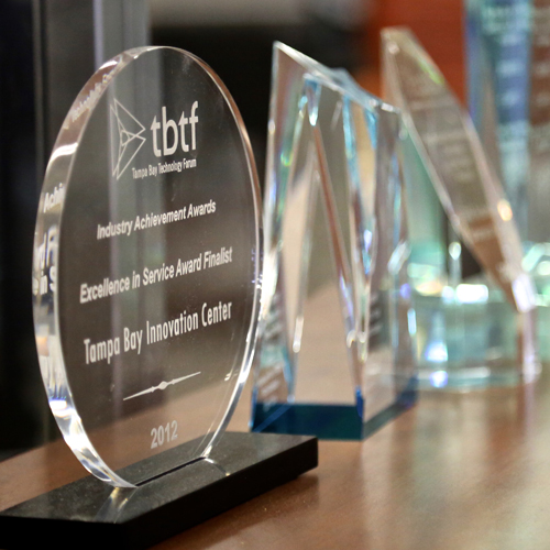 awards for Tampa Bay Innovation Center on a desk