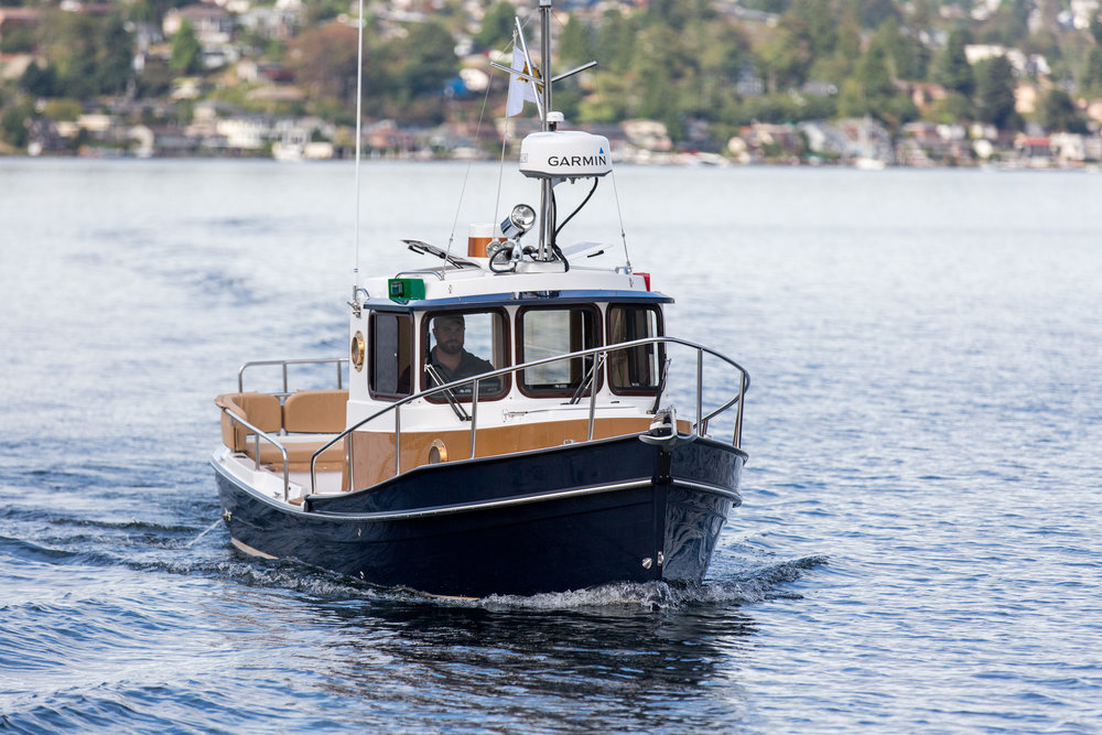 Ranger Tugs R21-EC   - The Ranger R-21EC  has earned a loyal following among enthusiasts who enjoy cruising at its classic best. Owners of this popular vessel have always measured fuel use in pints per hour, not gallons. Inspired by a traditional Bristol Bay trawler design, the Ranger R-21EC will never go out of style, ensuring both lasting appeal and maximum resale value. Easily trailerable, this boat rewards its owner with a level of versatility that few other cruisers can match.Courtesy of Seattle Boat Share.